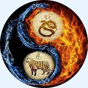 Мужчина-Змея и женщина-Тигр